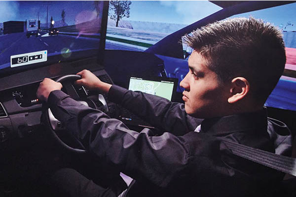 Student using the driving simulator